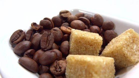 Coffee beans and brown sugar presentation