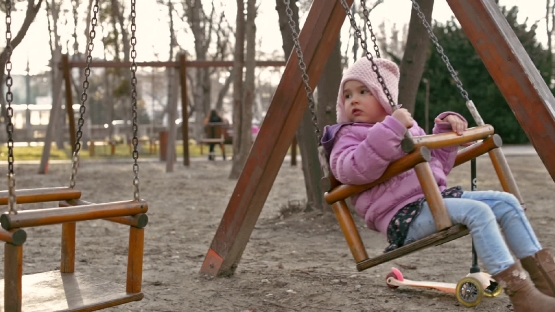 Little girl on swings
