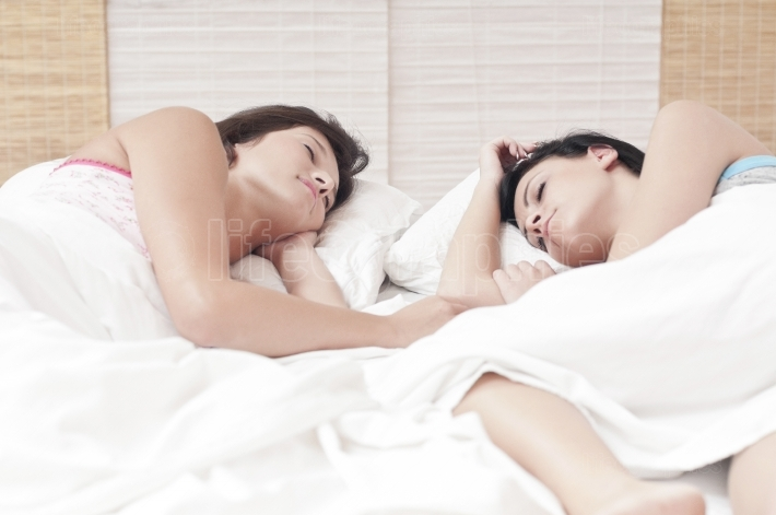 Females sleeping together