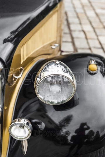 Great detail with the front light of a vintage car