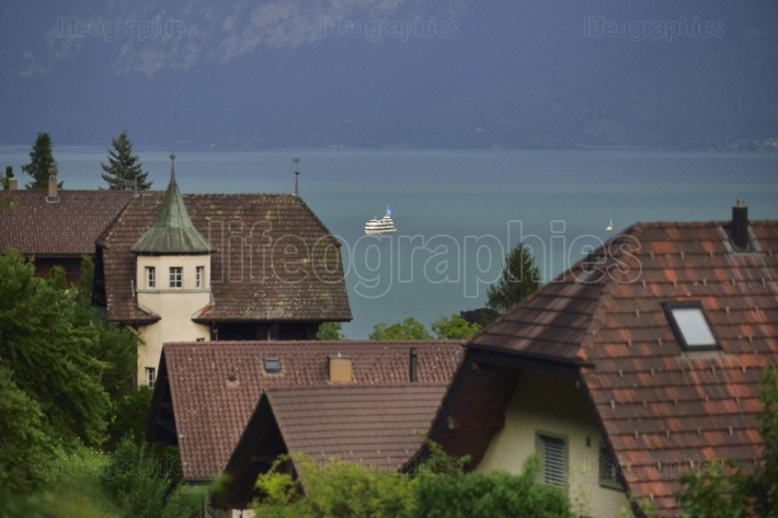 Mountain scene with Thun city and boat  at Thunnersee. Switzerland