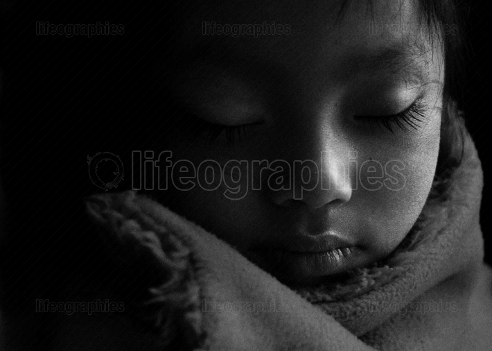 Sleeping quechua boy from Huaraz village.