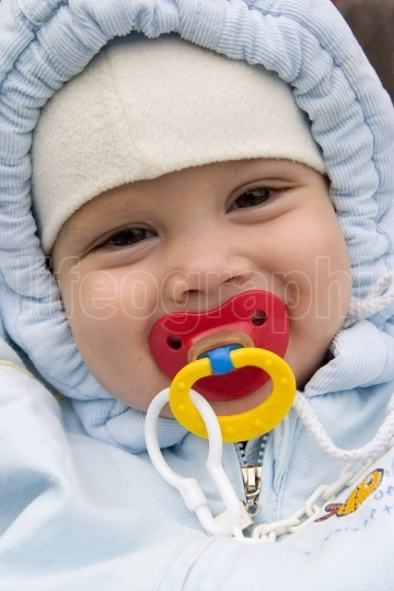Smiling baby with pacifier