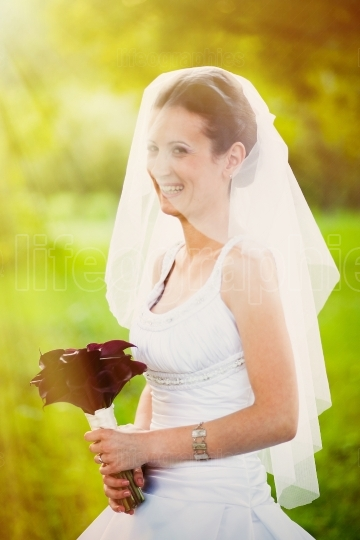 Smiling bride outdoors