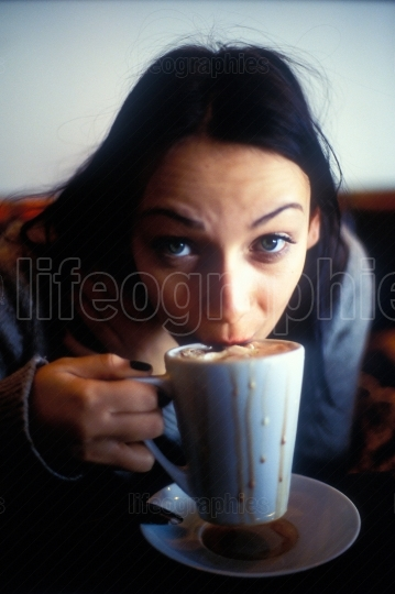 Thirsty woman on latte