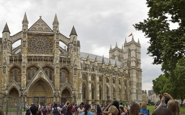 Westminster Abbey with people waiting for entrance, London