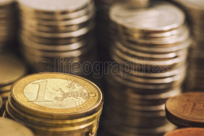 1 (one) euro coin between other currencies