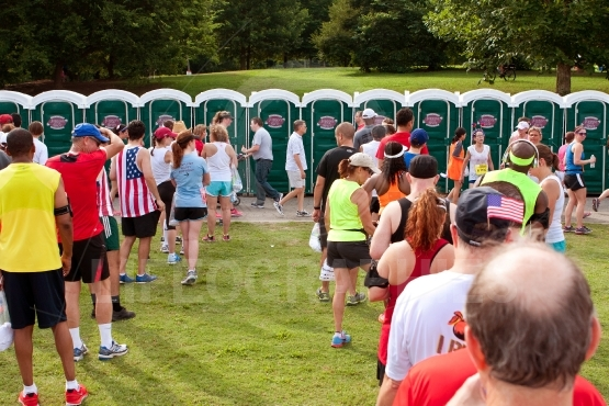 10K Runners Wait In Line To Use Portable Toilets