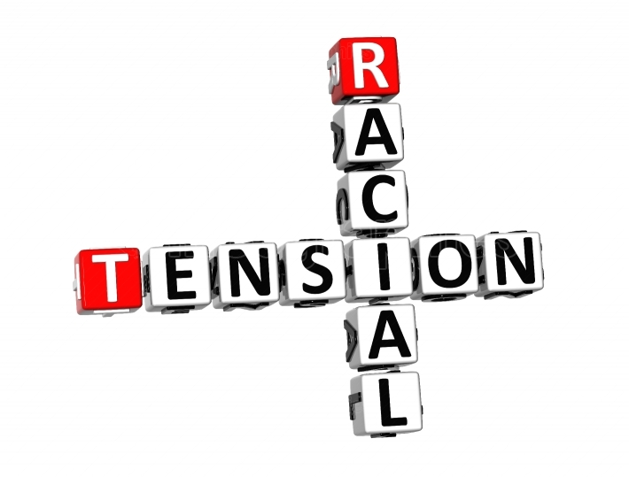 3D Crossword Racial Tension on white background