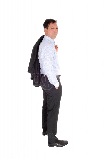 A business man standing with his jacked over shoulder