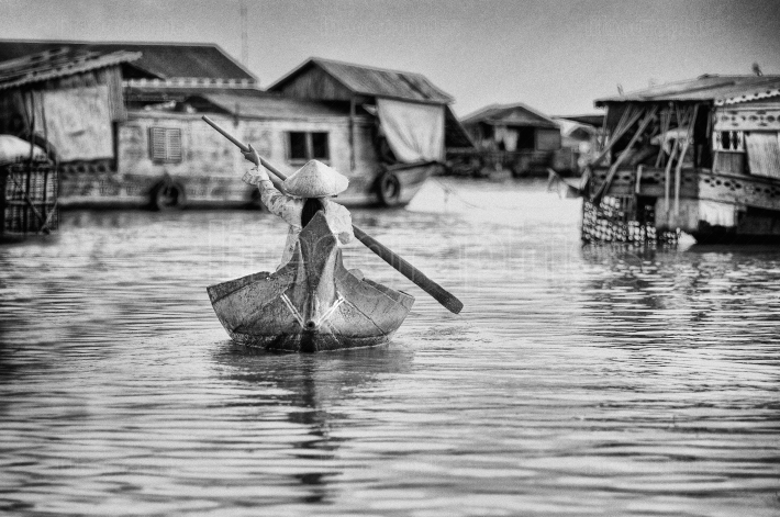 A cambodian woman in a boat in the floating village of kompong luong on the tonle sap lake