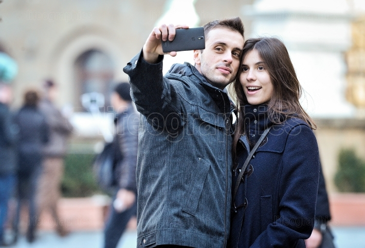 A couple takes a selfie