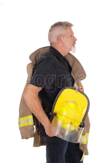 A firefighter standing in profile