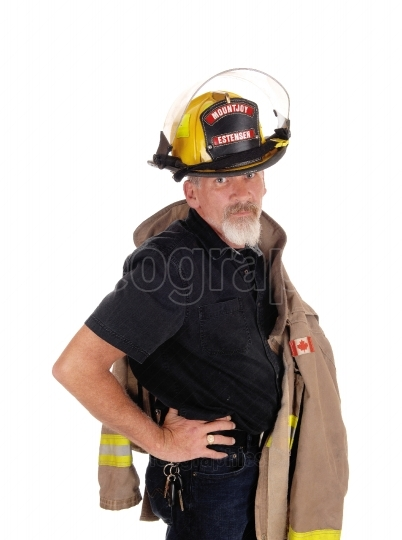 A firefighter standing with his helmet on