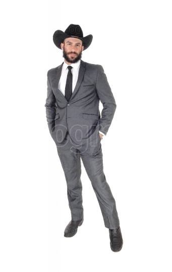 A full body portrait image of a man in s suit