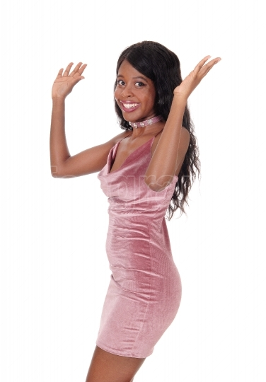 A happy African woman in a pink dress