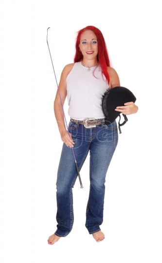 A horseback rider woman with helmet.