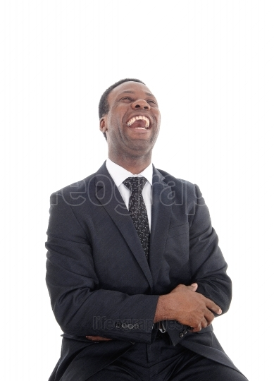 A laughing African man with his head back