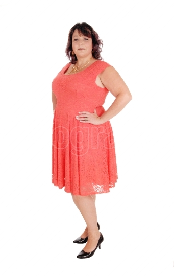 A plus size woman standing in a dress
