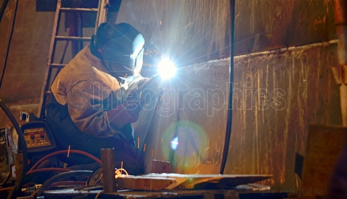 A welder working at shipyard
