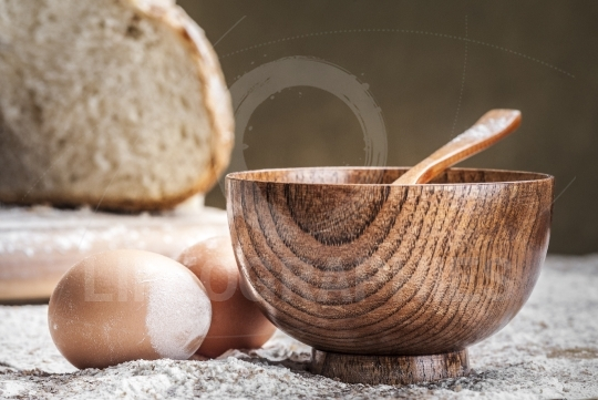 A wooden bowl and two eggs