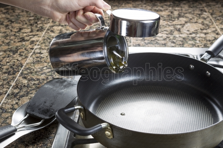 Adding cooking oil in frying pan