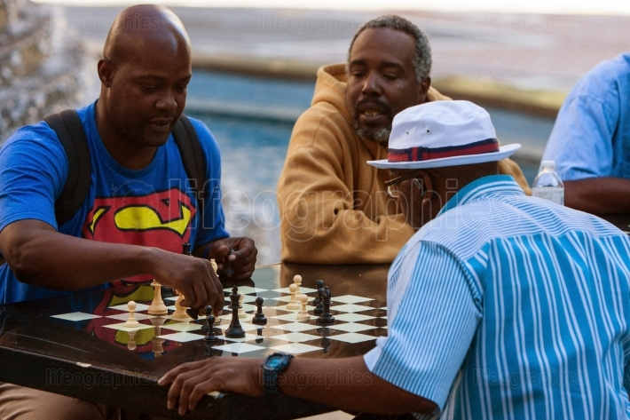 African American Men Play Chess Outdoors At Atlanta Public Park