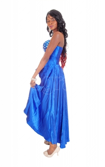 African american woman in blue dress in profile.