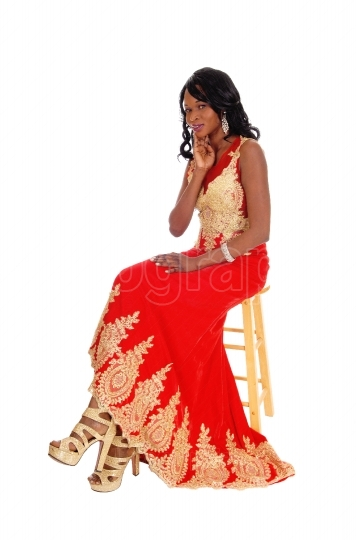 African American woman in dress.