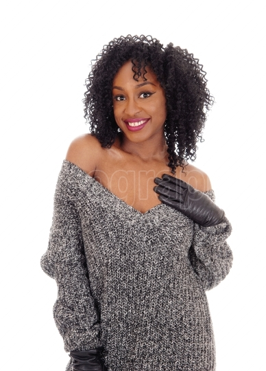 African American woman in gray sweater.