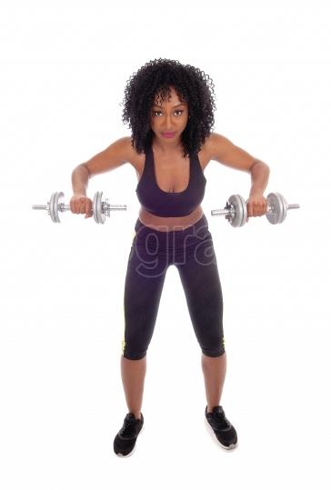 African american woman with dumbbell's.