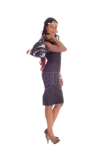 African American woman with purse.