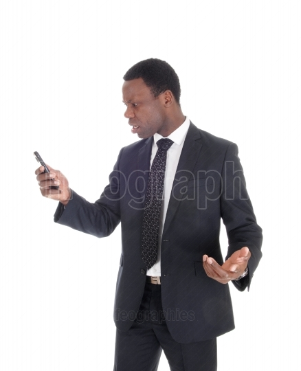 African man looking at his cell phone