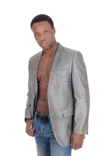 African man standing with jacked shirtless