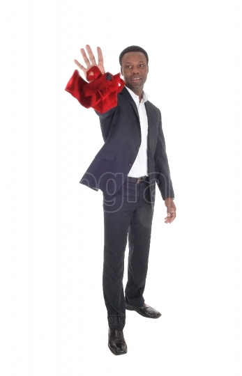 African man throwing his red tie away