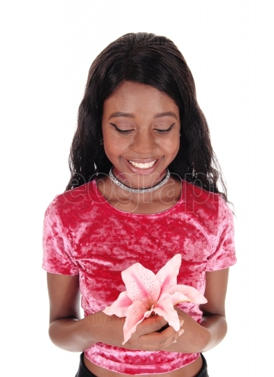 African woman holding pink lily