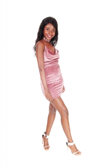African woman in a pink dress posing