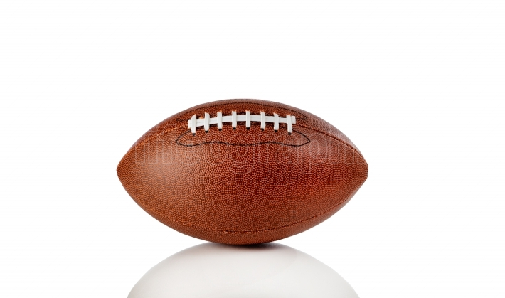 American football isolated on a white background with reflection