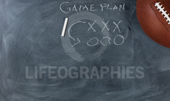 American football with game plan on chalkboard setting