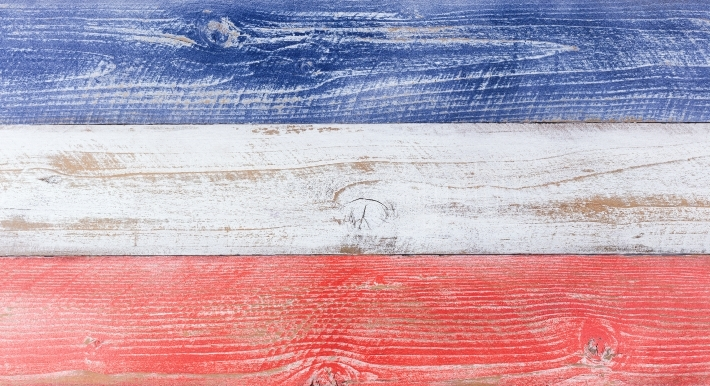American national colors painted on fading wooden boards