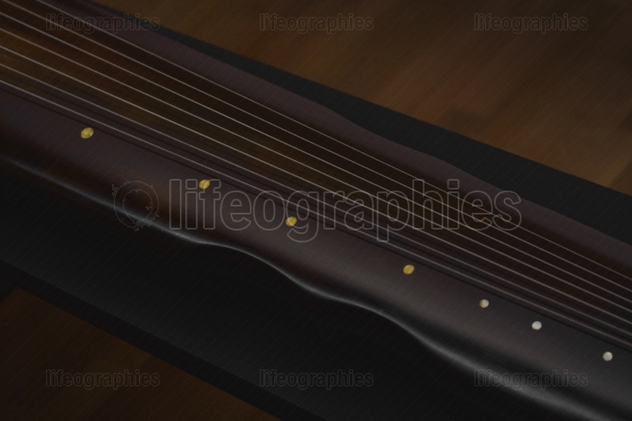 Ancient Chinese musical instrument GuQin with chromatic tuner
