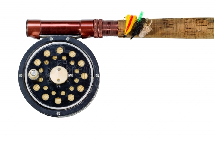 Antique fly reel and rod on white background