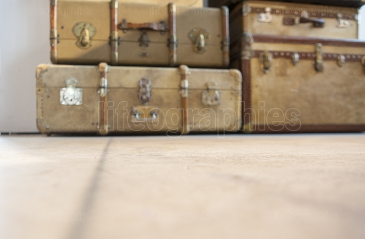 Antique luggage suitcases on the floor  Defocused