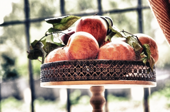 Apples over copper metal tray