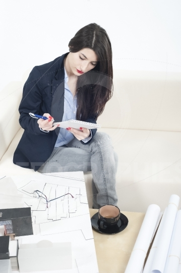 Architect girl working on a new architecture model