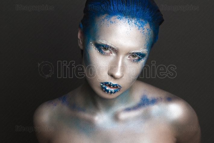Artistic Makeup with Blue Hair and Rhinestones