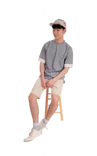 Asian man sitting and smiling
