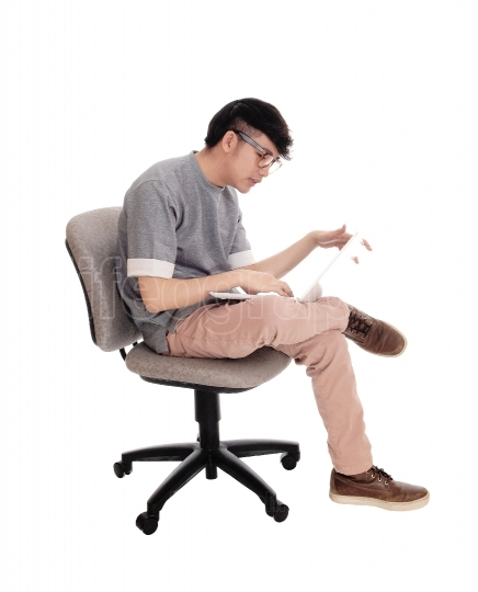 Asian man working at his laptop
