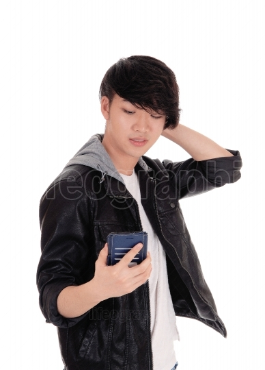 Asian teenager looking at his cellphone
