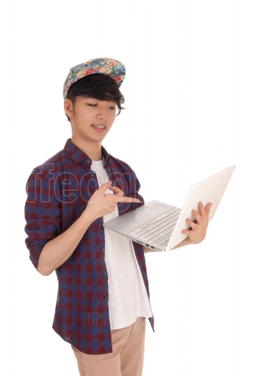 Asian teenager pointing at his laptop
